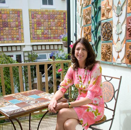 Kay on Ceramic House balcony